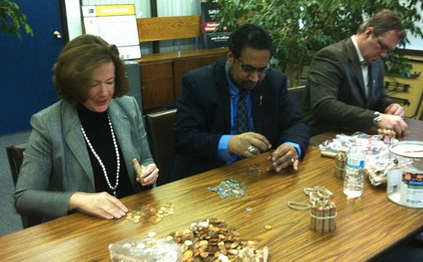Falling behind in fundraising, Premier Alison Redford and MLAs Peter Sandhu and Steven Young count their pennies.