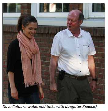 Dave Colburn walks and talks with daughter Spence.