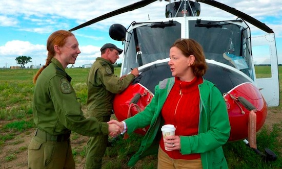 Premier Alison Redford shakes the hand of a Canadian Forces member providing relief for flooding in southern Alberta.