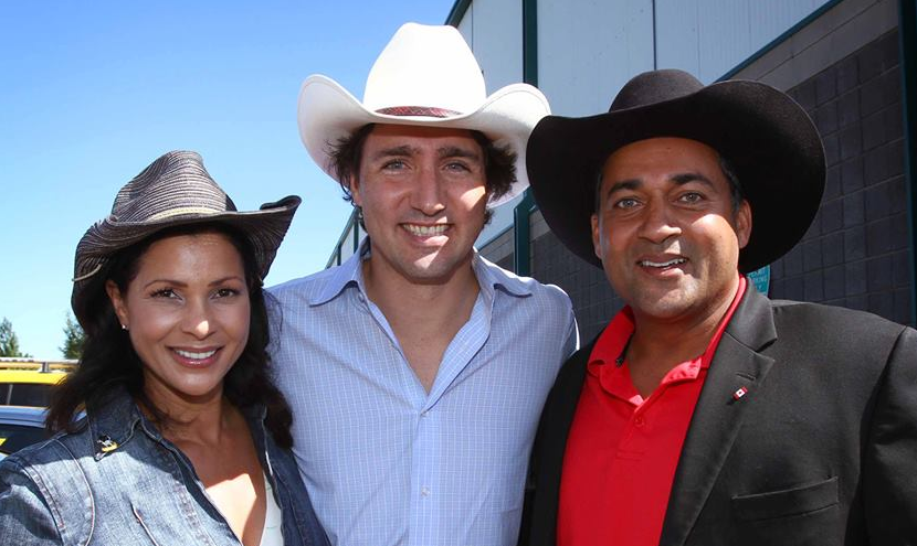 Alberta Liberal leader Raj Sherman (right), Justin Trudeau (centre), and Sherman's partner Sharon (left) at the Calgary Stampede.