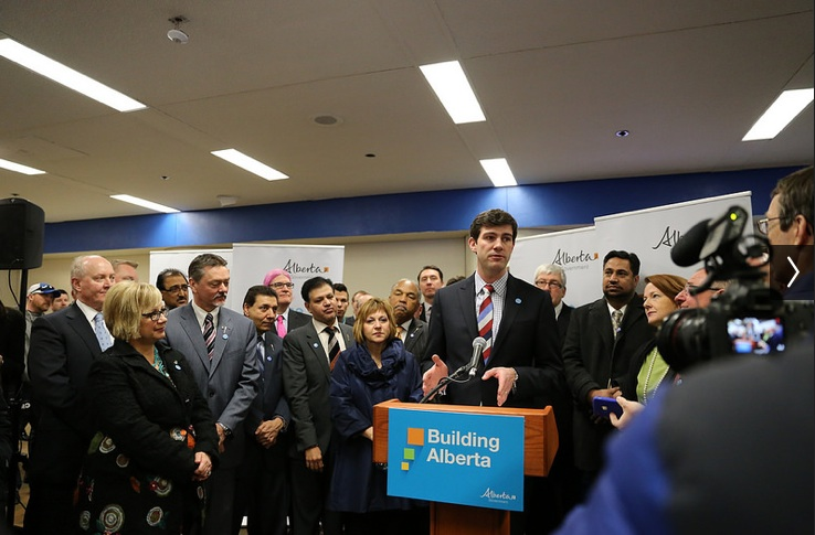 Mayor Don Iveson, surrounded by Edmonton city councillors and PC MLAs (photo by mastermaq, creative commons licensed)