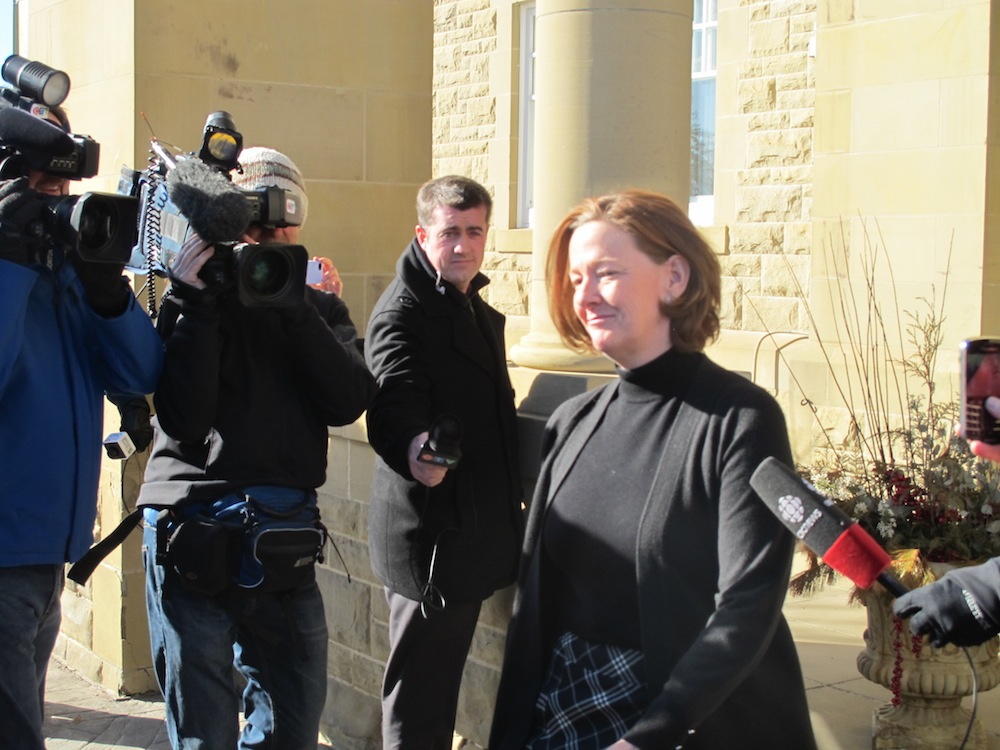 Premier Alison Redford quickly departs Government House.