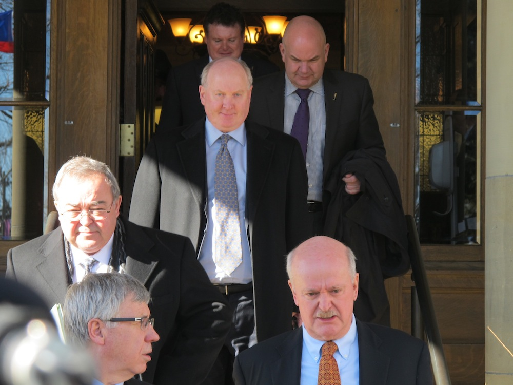 Old white men: Progressive Conservative MLAs leave their Thursday morning caucus meeting at Government House.