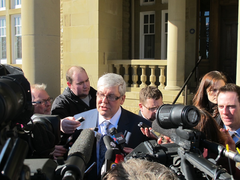 Deputy Premier Dave Hancock scrums with the media after the PC caucus meeting.