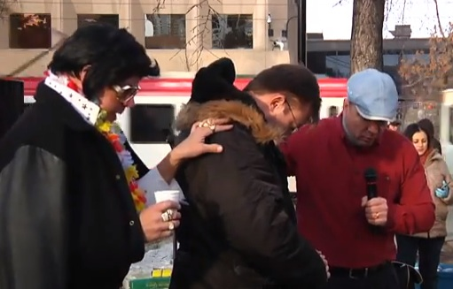 Rob Anders, being blessed by controversial Calgary street pastor Art Pazlowski and Gospel Elvis.