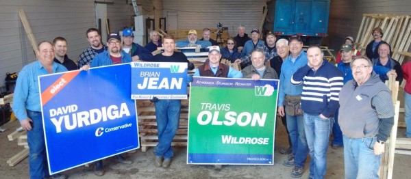 Conservative MP David Yurdiga and Wildrose leader Brian Jean pose with volunteers.