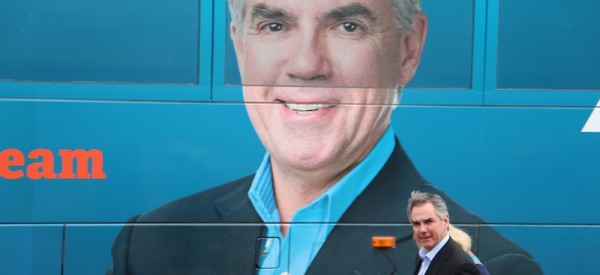 Jim Prentice is dwarfed by a giant photo of himself on the PC campaign bus at a stop in Edmonton this week.