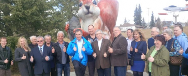 A Giant Squirrel poses with Jim Prentice, Robin Campbell and PC Party supporters in Edson.