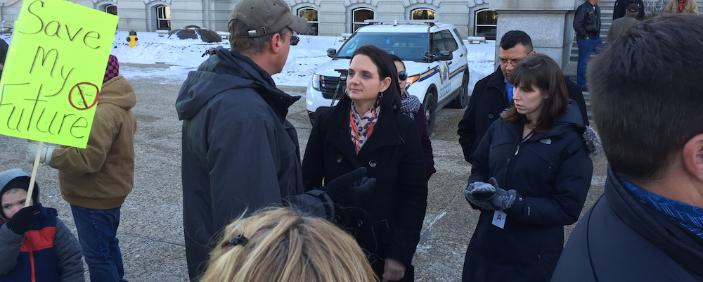 Danielle Larivee waded into the crowd of protesters outside the Legislature.