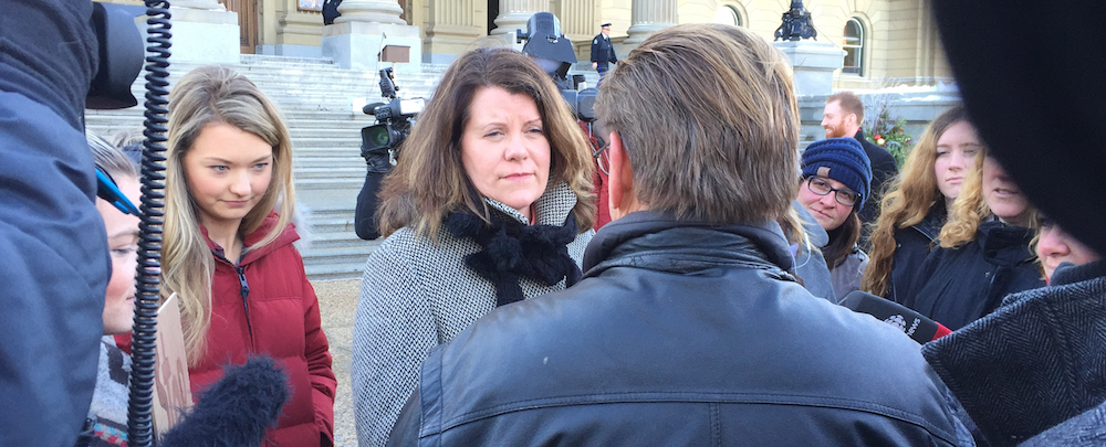 Lori Sigurdson waded into the crowd of protesters outside the Legislature.