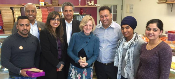 Premier Rachel Notley (centre), Human Services Minister Irfan Sabir (fourth from left) and NDP candidate Roop Rai (third from left) at a campaign stop in Calgary-Greenway.