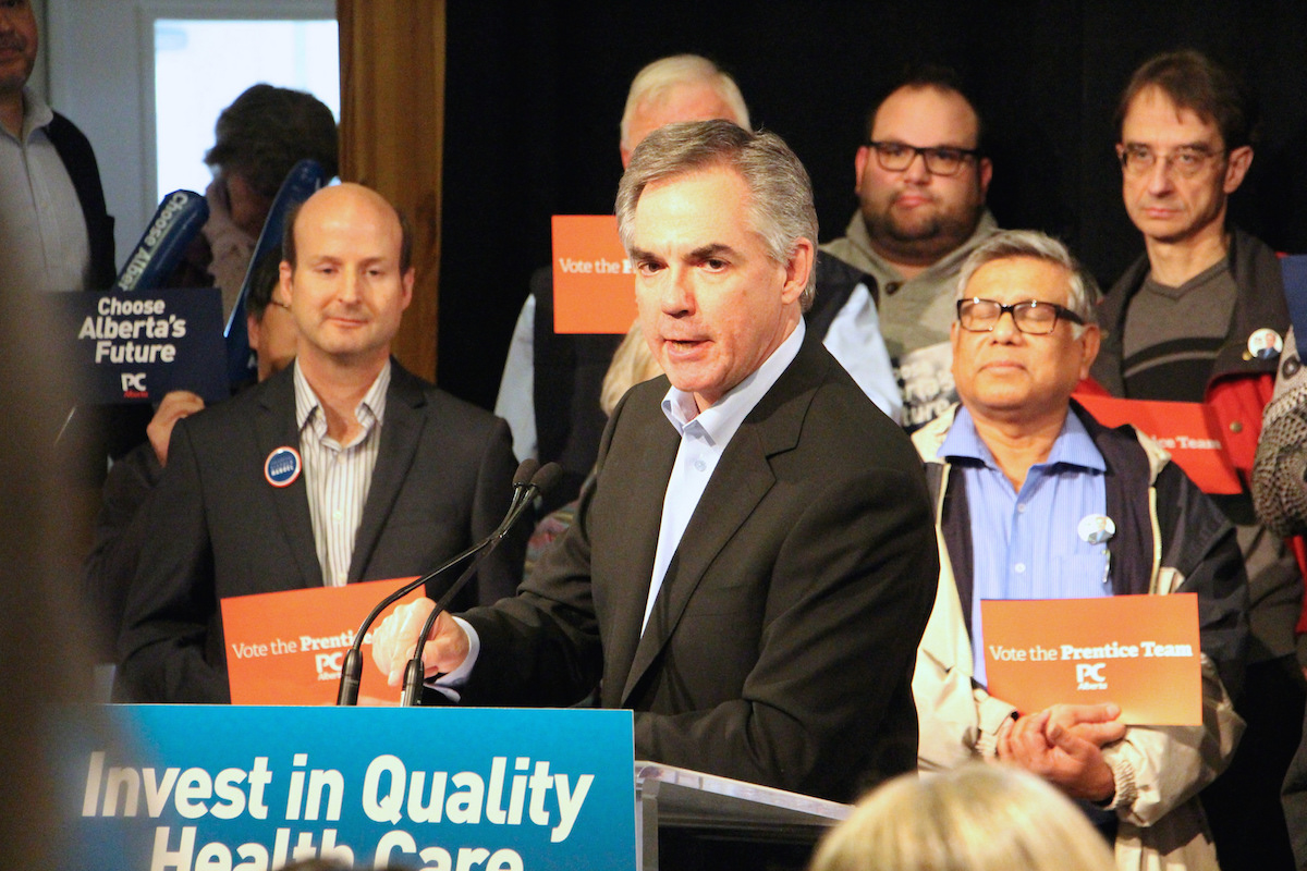 Jim Prentice speaks at the podium of his campaign rally on April 14, 2015.