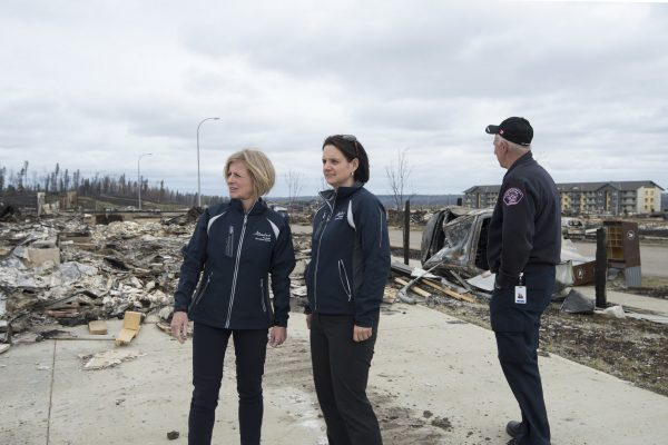 Premier Rachel Notley and Municipal Affairs Minister Danielle Larivee survey the wildfire damage in Fort McMurray.