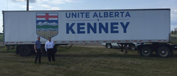 Jason Kenney stands in front of a supportive truck trailer in Grande Prairie.