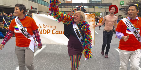 Alberta Premier Rachel Notley marches in the 2016 Calgary Pride Parade with MLAs Estefania Cortes-Vargas (left) and Ricardo Miranda (right). (Photo from Rachel Notley's Facebook Page)