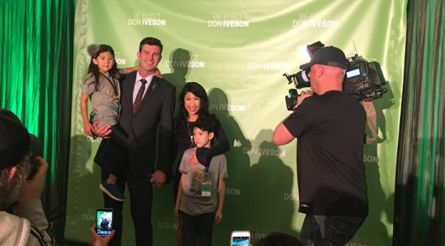 Don Iveson with his wife, Sarah Chan, and their children on the night of his re-election in 2017.