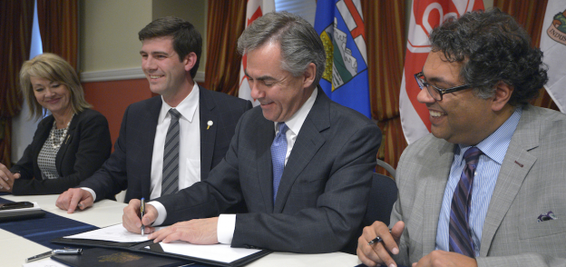 Photo: Diana McQueen, Don Iveson, Jim Prentice and Naheed Nenshi sign the Framework Agreement that paved the way for the development of city charters on Oct. 7, 2014 (Photo source: Government of Alberta on Flickr)