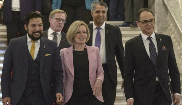 Photo: Culture Minister Ricardo Miranda, Education Minister David Eggen, Premier Rachel Notley, Community and Social Services Minister Irfan Sabir and Finance Minister Joe Ceci walk out of the Legislative chambers following the Speech from the Throne. (photography by Chris Schwarz/Government of Alberta)