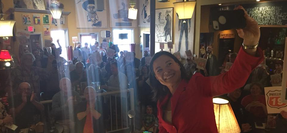 Shannon Phillips takes a selfie in front of a crowded nomination meeting in Lethbridge-West.