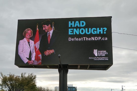 A billboard advertisement from the Shaping Alberta's Future PAC.