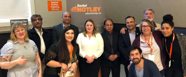NDP MLA Deborah Drever, centre in white, with supporters at the NDP nomination meeting in Calgary-Bow.