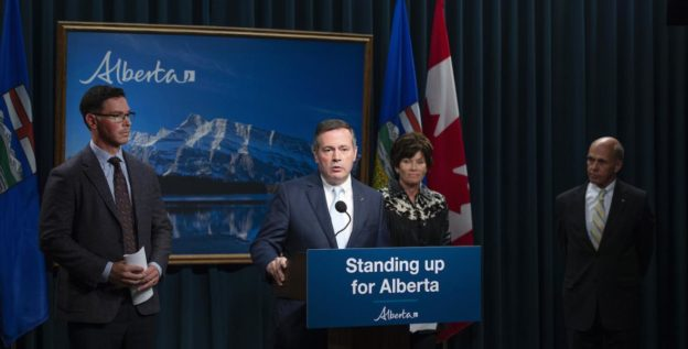 Premier Jason Kenney (at the podium) announces the appointment of Steve Allan (right) as Commissioner of the Public Inquiry into Anti-Alberta Energy Campaigns.Also pictured are then-Justice Minister Doug Schweitzer and Energy Minister Sonya Savage.