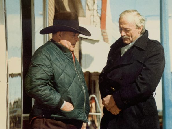 Nick Taylor (right) talks with a cowboy.