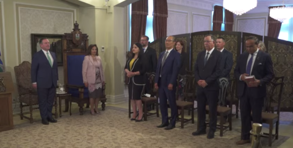 Premier Jason Kenney, Lieutenant Governor Salma Lakhani and the new cohort of cabinet ministers.