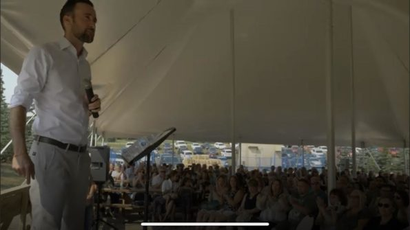 Derek Sloan speaking to a crowd in Calgary.